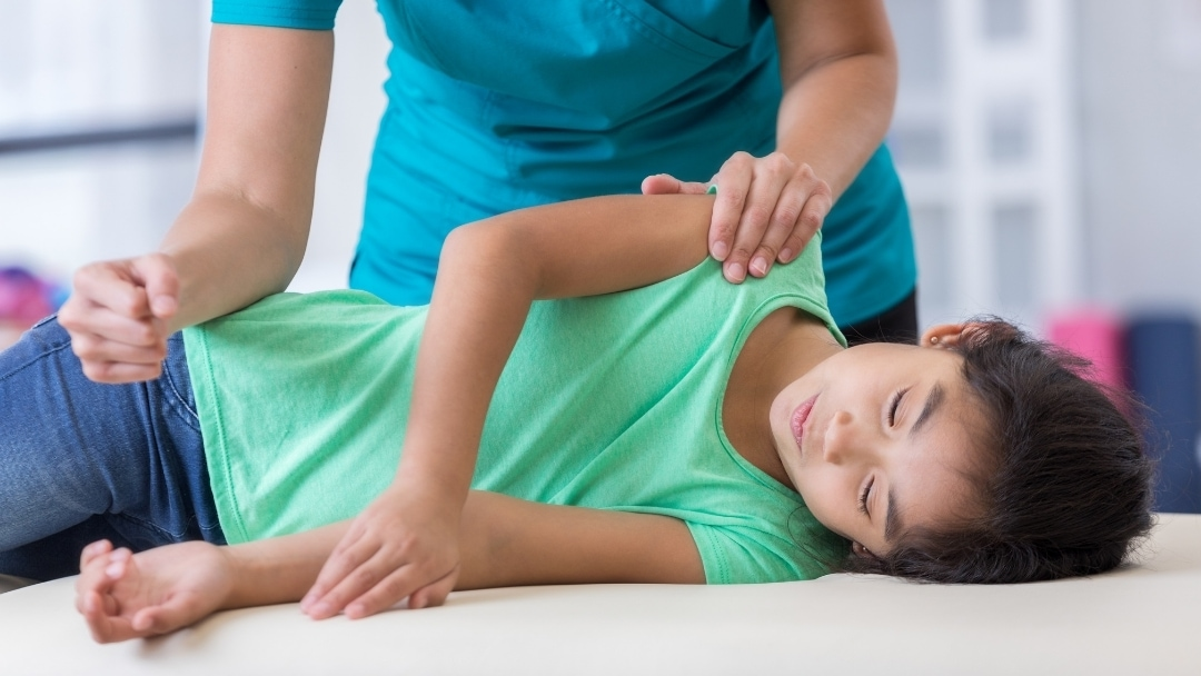 child with structural problems at chiropractor